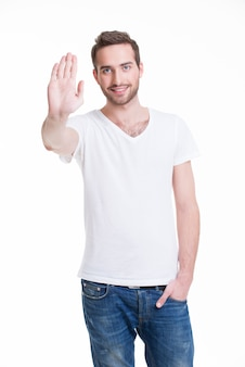 彼の手で停止を必要とする若い幸せな男-白で隔離。