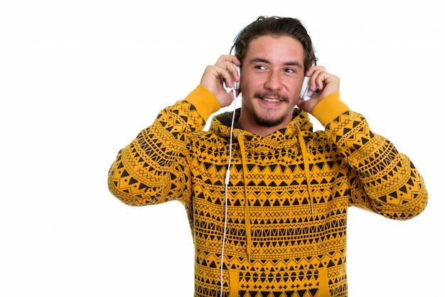 Young happy man smiling while listening to music