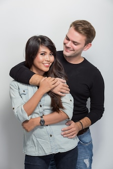 Young happy multicultural couple