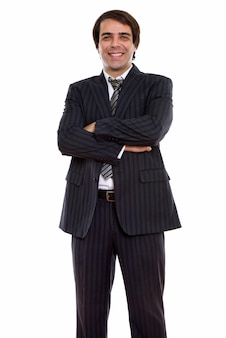 Young happy persian businessman smiling and stand with crossed arms
