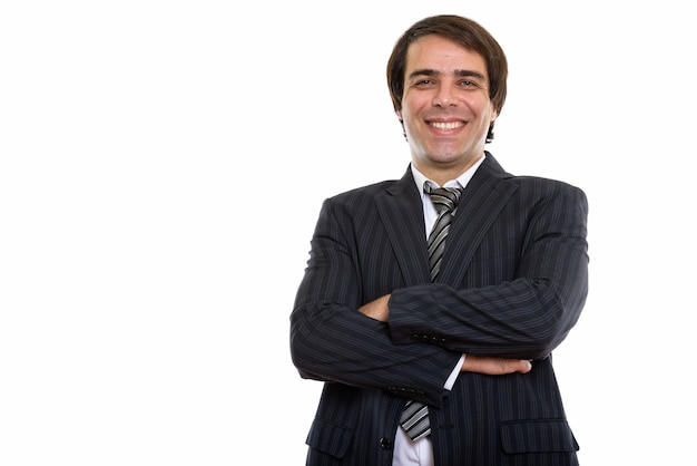 Young happy persian businessman smiling with arms crossed
