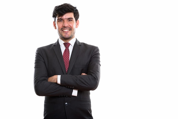 Young happy persian businessman smiling with arms