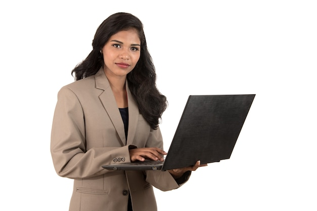 Young happy smiling woman holding laptop.