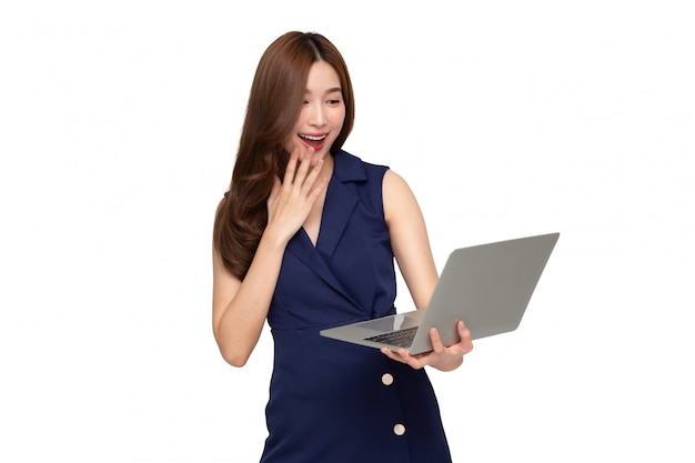 Young happy smiling woman holding laptop