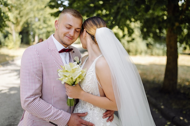 Young happy wedding couple. caucasian bride and groom embracing