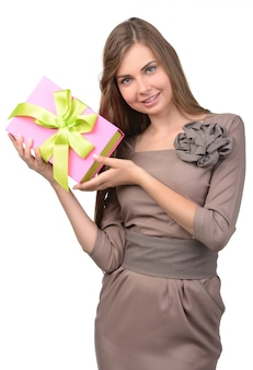 Young, happy woman holds a box with a gift.