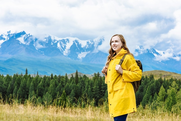 Young happy woman tourist with a backpack as travel and vacation concept
