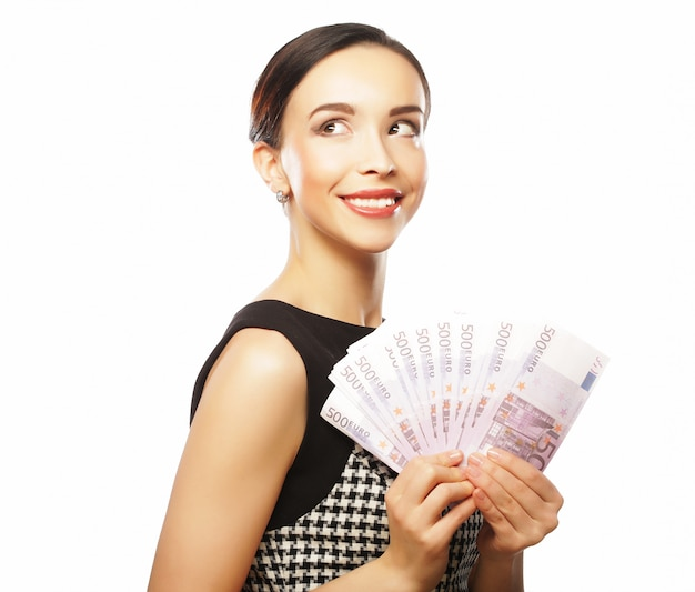 Young happy woman with dollars in hand.