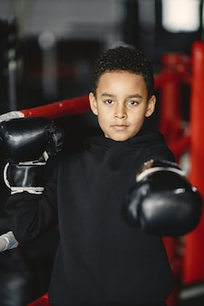 Young hardworking boxer learning to box. child at sport center. kid taking up a new hobby