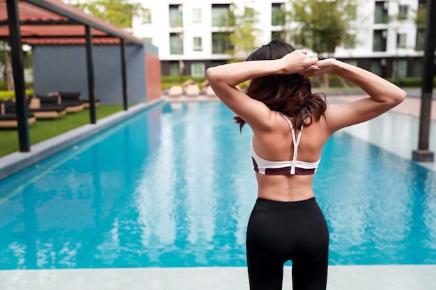 Young healthy and sporty woman do yoga stretching outdoor