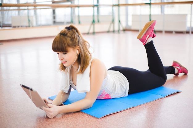 Young healthy woman take a rest in fitness