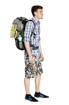 Young hiker with a backpack on a white background