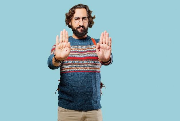Young hippie man stop gesture