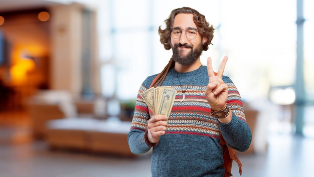 Young hippie man with banknotes