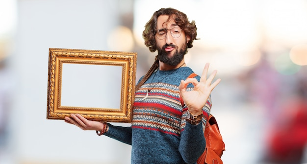 Young hippie man with a baroque frame