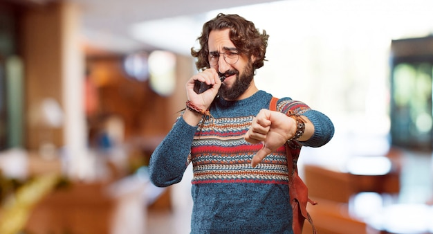 Young hippie man with a electronic cigarette