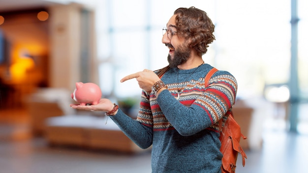 Young hippie man with a piggy bank