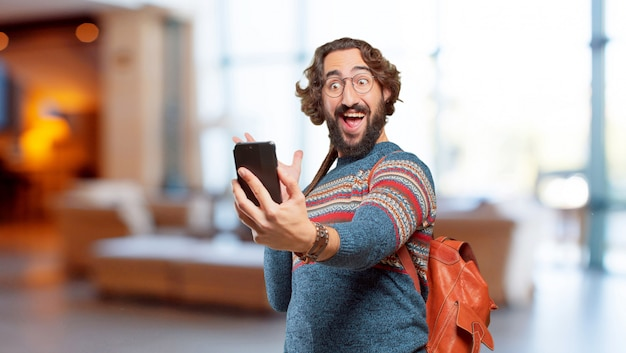 Young hippie man with a smart phone