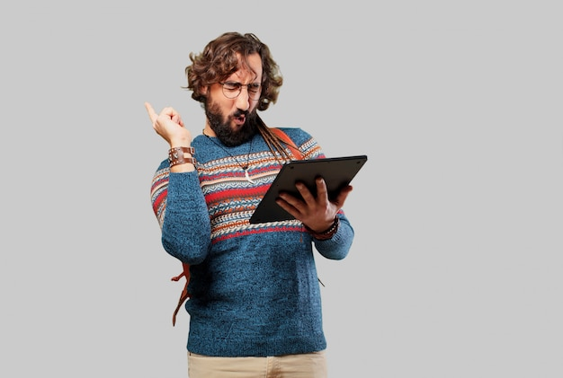 Young hippie man with a tablet