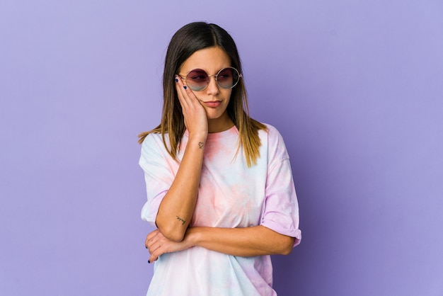 Young hippie woman isolated on purple background who is bored, fatigued and need a relax day.