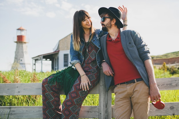 Young hipster couple indie style in love walking in countryside