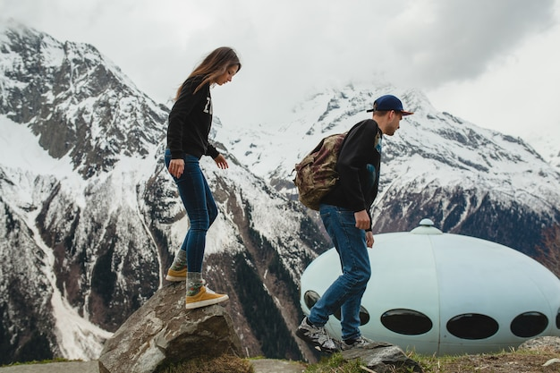 Young hipster couple in love walking in mountains