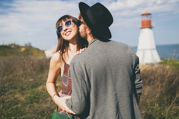 Young hipster couple posing in the countryside