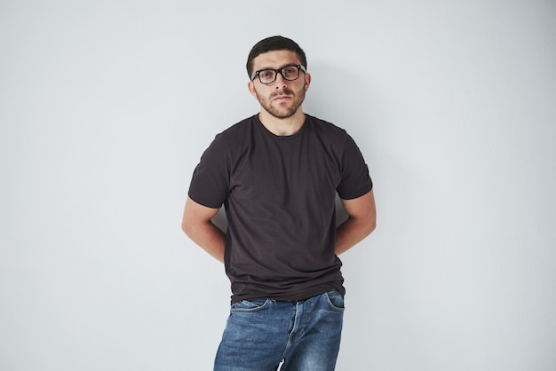 Young hipster guy wearing glasses laughing happily isolated on white