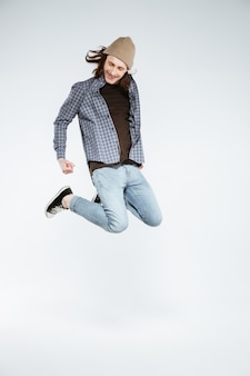 Young hipster man jumping