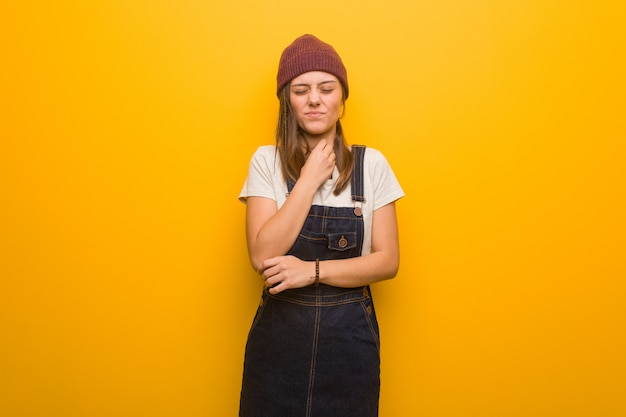 Young hipster woman coughing, sick due a virus or infection