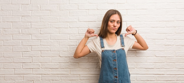 Young hipster woman pointing fingers, example to follow
