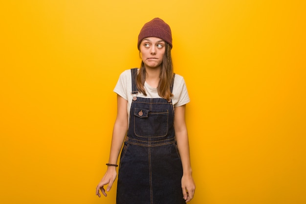 Young hipster woman thinking about an idea