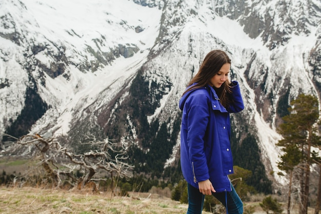 Young hipster woman walking in mountains