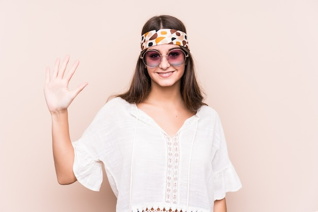 Young hipter caucasian woman isolated smiling cheerful showing number five with fingers.