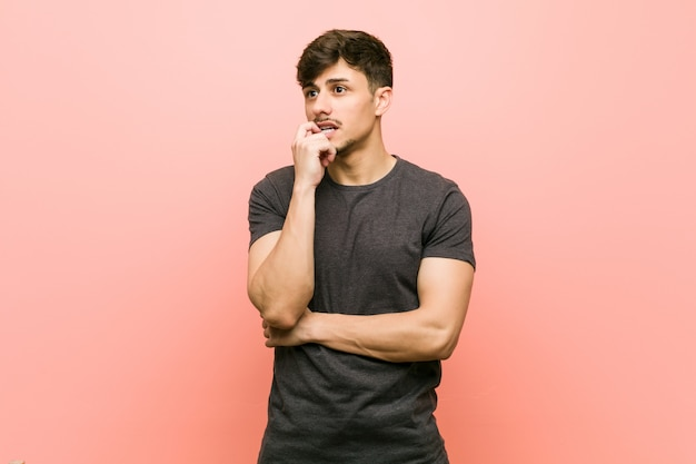 Young hispanic casual man relaxed thinking about something looking at a copy space.