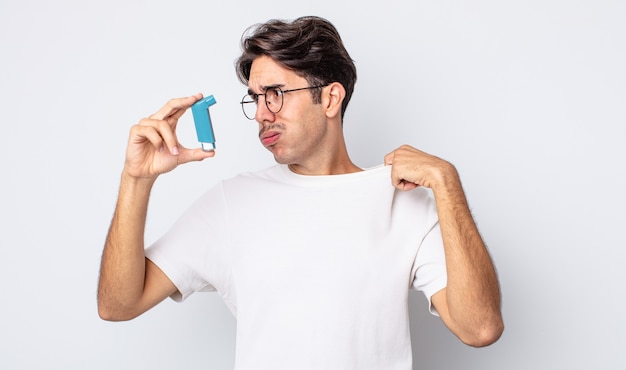 Young hispanic man feeling stressed, anxious, tired and frustrated. asthma concept