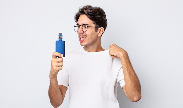Young hispanic man feeling stressed, anxious, tired and frustrated. smoke vaporizer concept