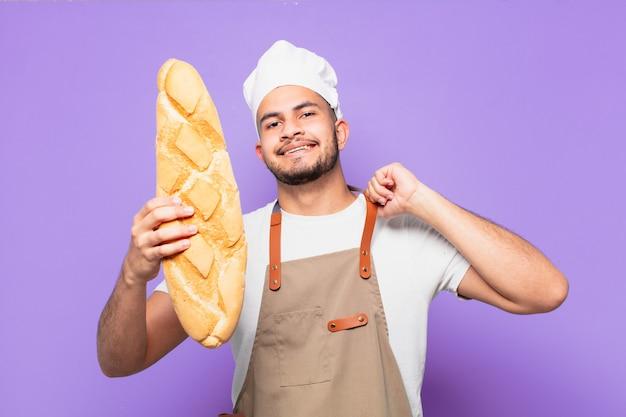 若いヒスパニック系男性の幸せな表現。シェフまたはパン屋のコンセプト