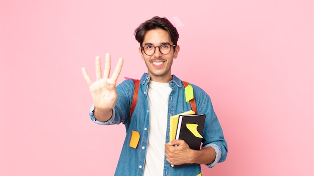 Young hispanic man smiling and looking friendly, showing number four. student concept