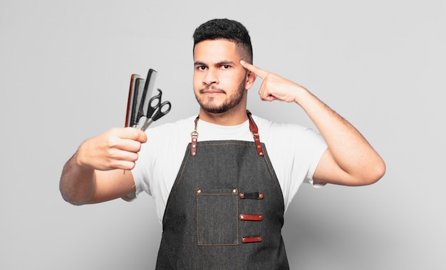 Young hispanic man thinking expression. barber concept
