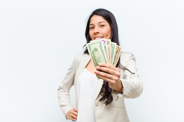 Young hispanic pretty woman with dollar banknotes