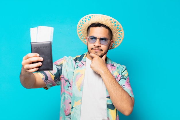 Young hispanic traveler man doubting or uncertain expression