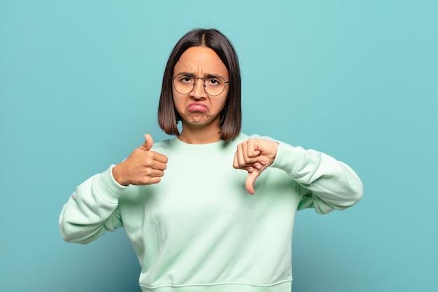 若いヒスパニック系女性は、混乱し、無知で、確信が持てず、さまざまなオプションや選択肢で良い点と悪い点を重視しています