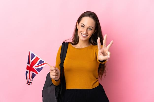 행복 한 영국 국기를 들고 손가락으로 세 세 젊은 히스패닉 여자