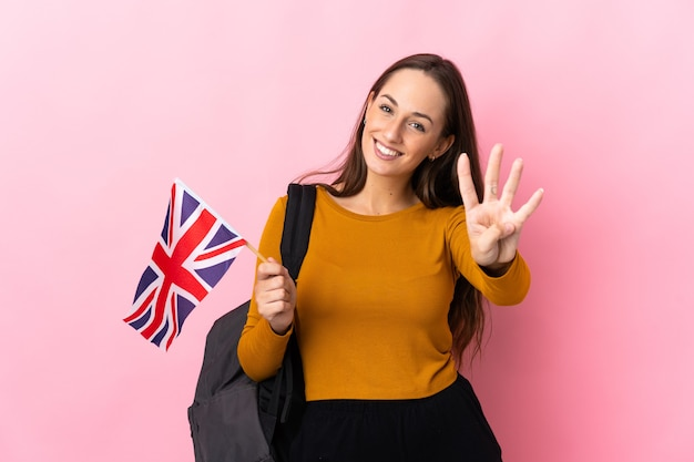 Young hispanic woman holding an united kingdom flag happy and counting four with fingers