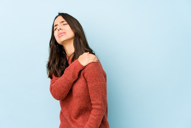 Young hispanic woman isolated having a shoulder pain