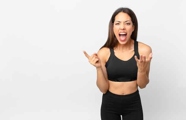 Young hispanic woman looking desperate, frustrated and stressed. fitness concept