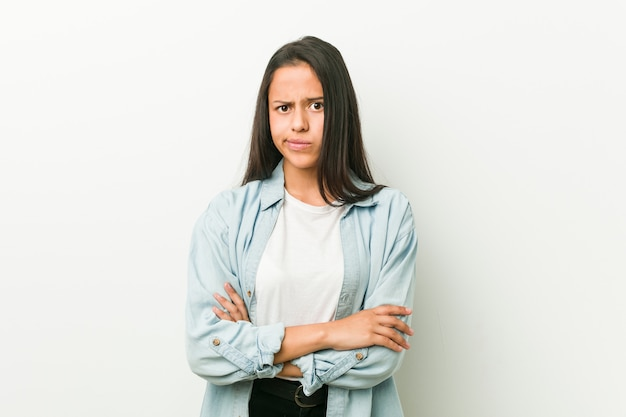 Young hispanic woman unhappy looking with sarcastic expression.