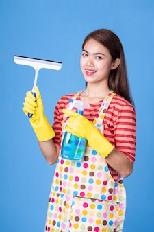 Young housekeeper female with cleaning supply