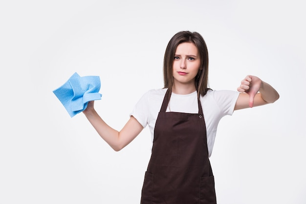 Young housewife with cleaning rag isolated. beautiful housekeeper woman showing thumbs down. for advertisement
